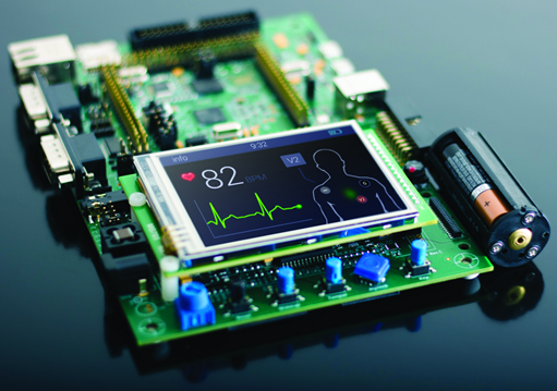 An example of an embedded system, a circuit board with an LCD, some buttons and a battery to power it.